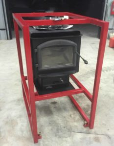 Metal frame for wood stove installation