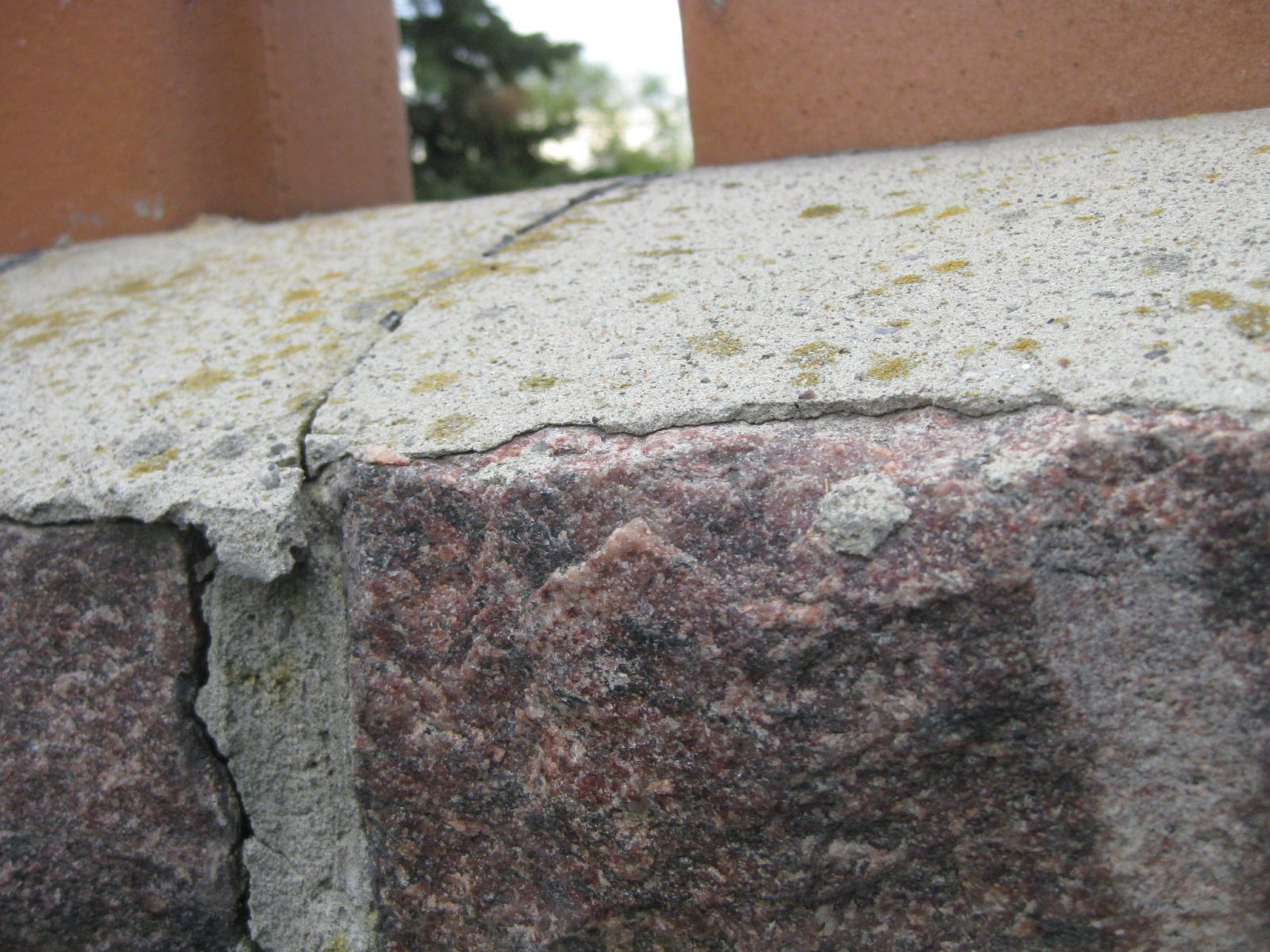 Mortar on chimney cap has cracked.  Water will enter chimney and cause further damage