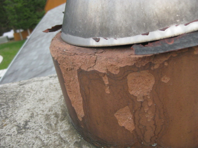 Clay Flue tile is deteriorating and requires repair.