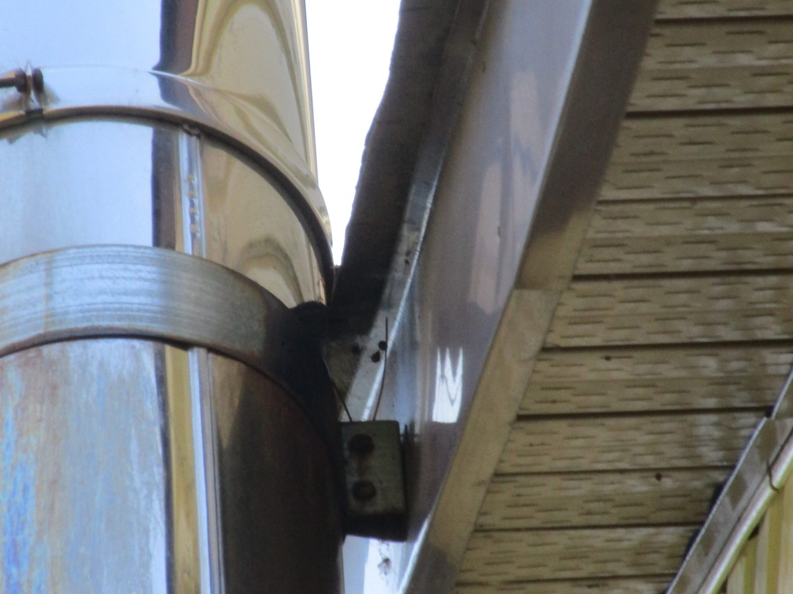 Stainless Steel Chimney Requires 2 inch clearance from shingles.