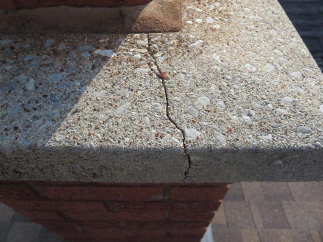 Chimney cap crack requires repair.