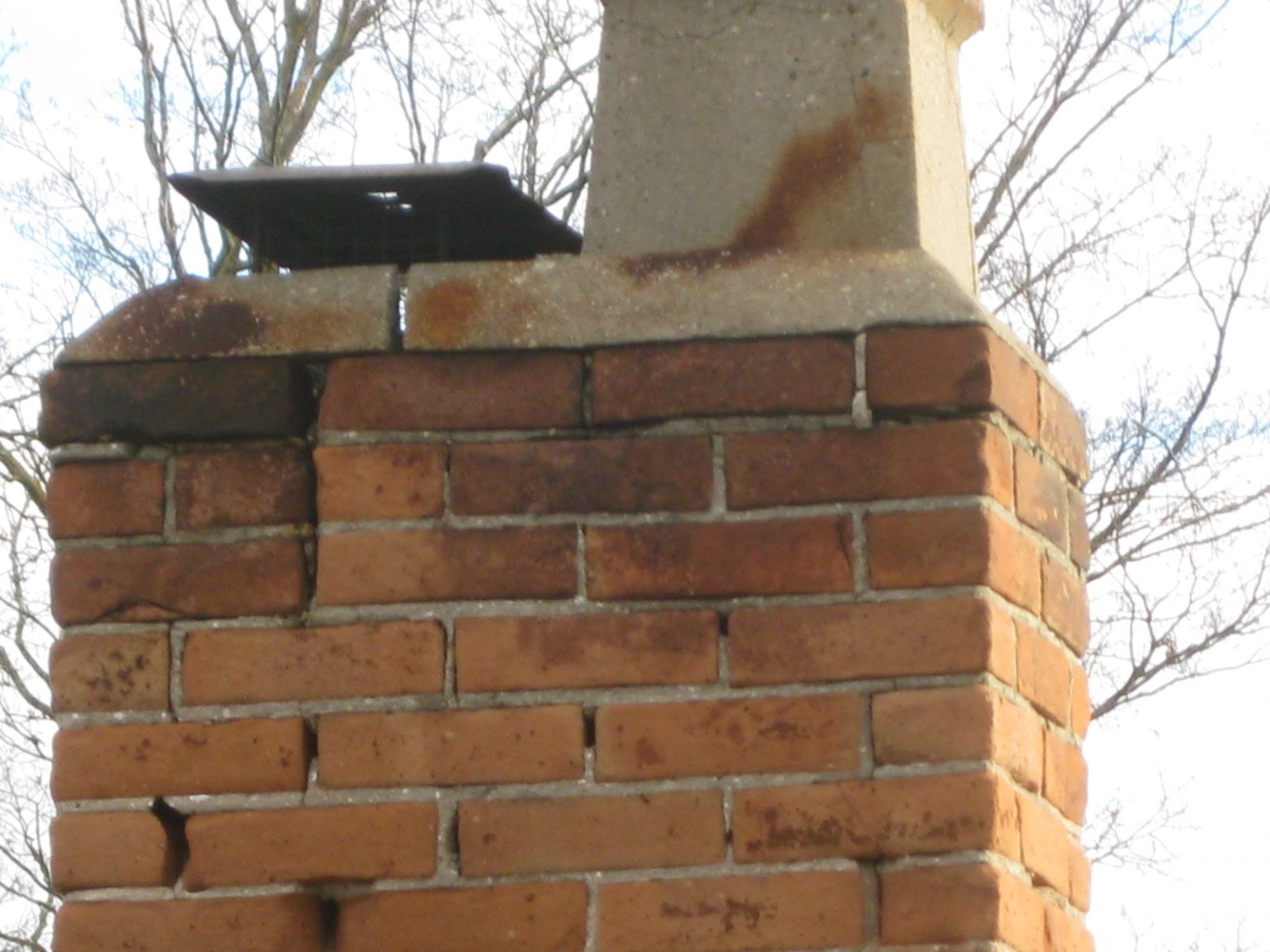 Chimney has structural damage and requires rebuilding.