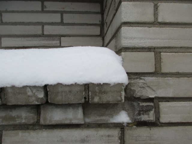 Chimney mortar joints have failed causing water damage to brick.