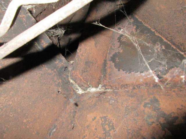 Metal is rusted with holes.  Fireplace will have to be rebuilt.