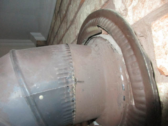 Flue pipe improperly installed and missing screws