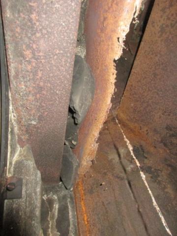 Firebox is rusting and masonry seal has failed.
