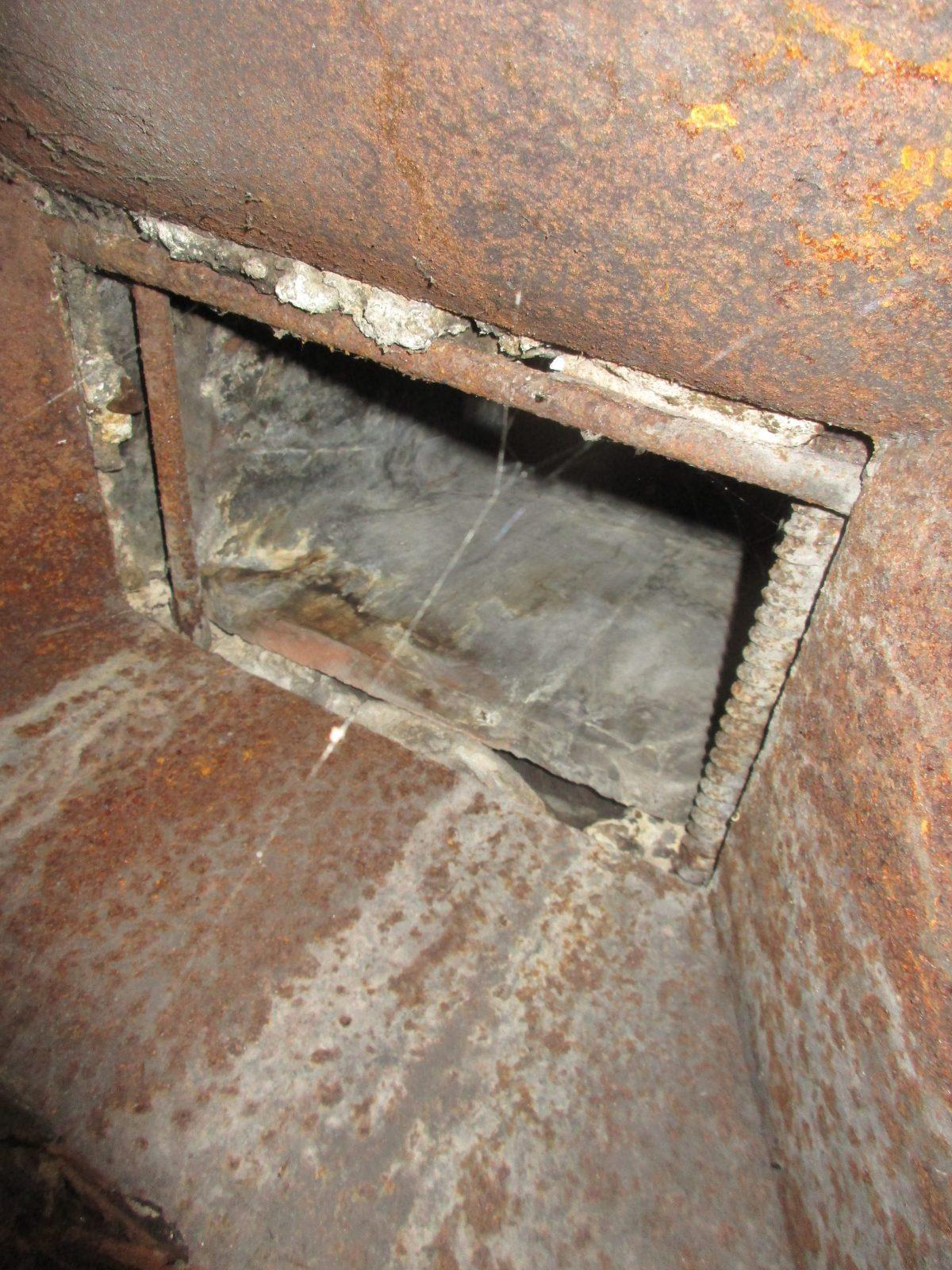 Gaps in flue pipe connection require repair.