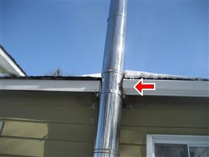 Chimney does not have the required 2 inch clearance to combustibles